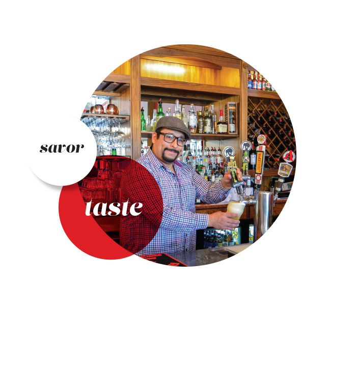 circular image with words; savor and taste depicting a bartender drawing draft beer from a tap