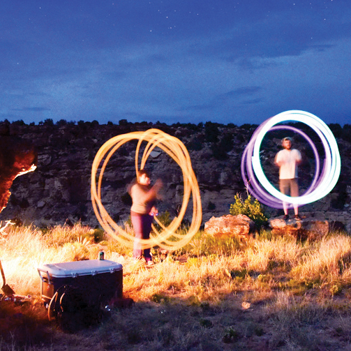 artistic photography displaying time lapsed captures of light circles around people