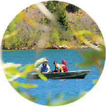 Circular image of three people in a boat