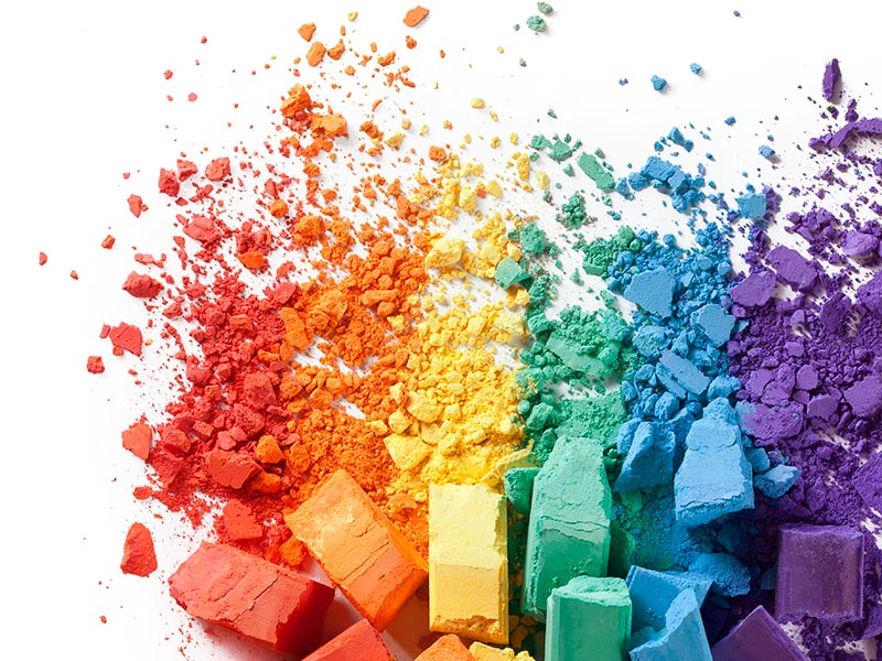 a rainbow color scheme of crushed chalk to represent Trinidad's art & culture scene