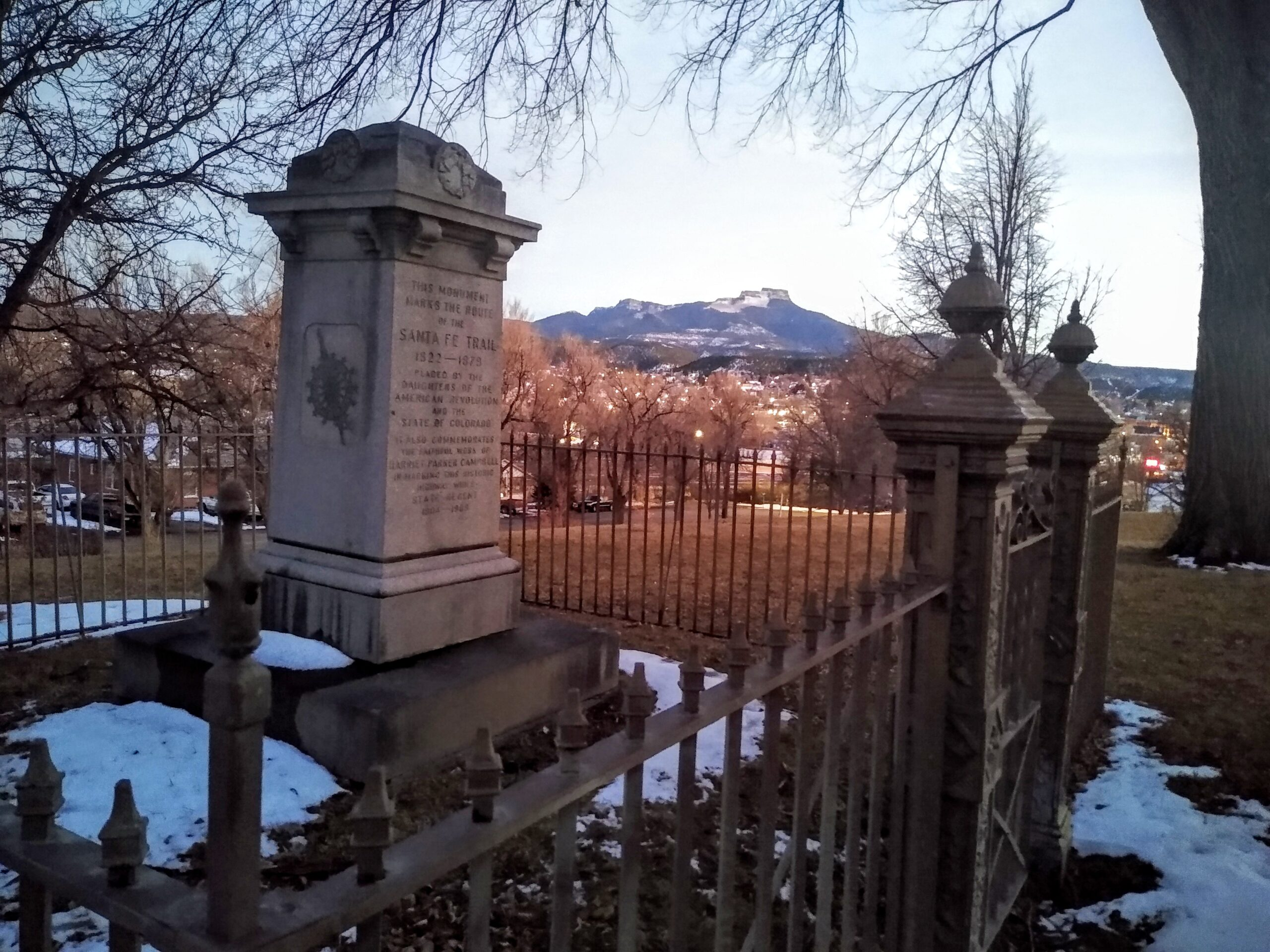 View of the Santa Fe Trail Marker in Kit Carson Park, Trinidad, Colorado, with Fisher's Peak in the background
