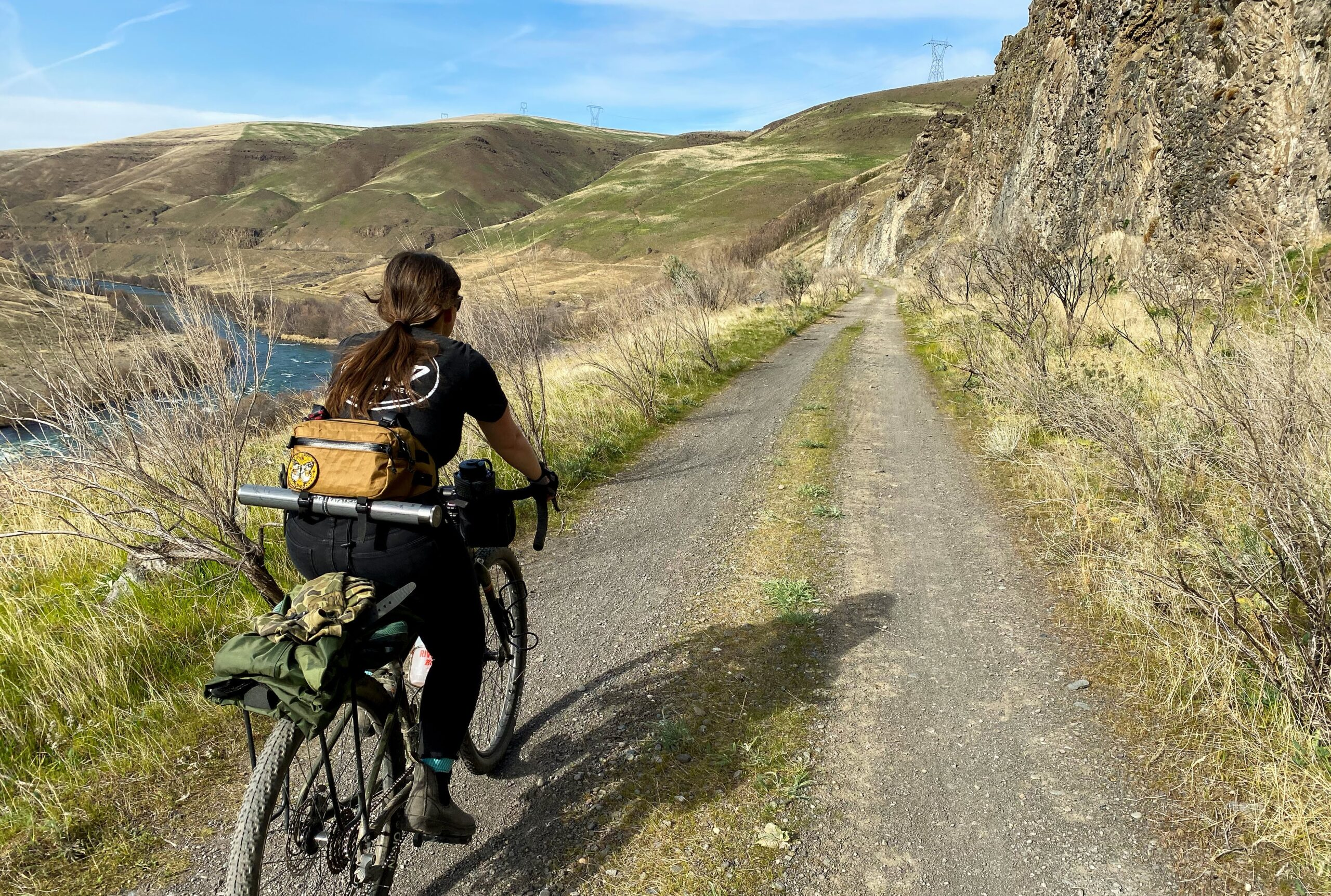Image from the Gravel Guide of Cyclist riding along the river